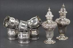 A Set of Five Sterling Silver Napkin Rings.