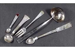 A Collection of Hand Wrought Sterling Silver Utensils.