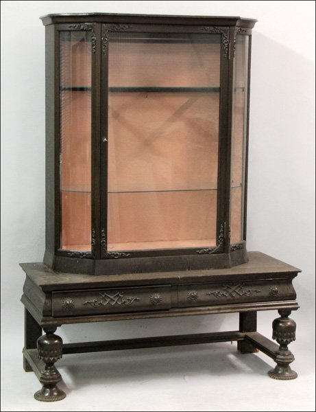 TUDOR STYLE CARVED OAK AND GLASS CABINET ON STAND.