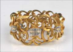 JOSEPH MAZER RHINESTONE AND SCROLLED GILT METAL BANGLE