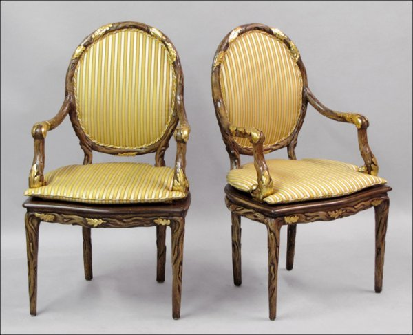 791006: PAIR OF GILT AND CARVED WOOD ARMCHAIRS.