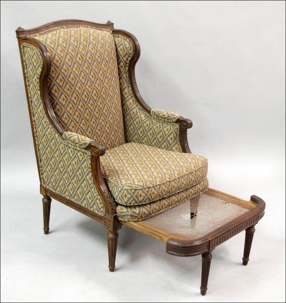 791019: CARVED AND UPHOLSTERED ARMCHAIR.