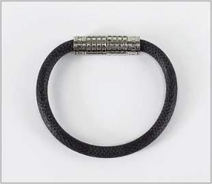 A Louis Vuitton Damier Graphite Digit Bracelet.
