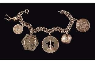 A 14 Karat Yellow Gold Charm Bracelet.