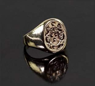 A 14 Karat Yellow Gold Signet Ring.