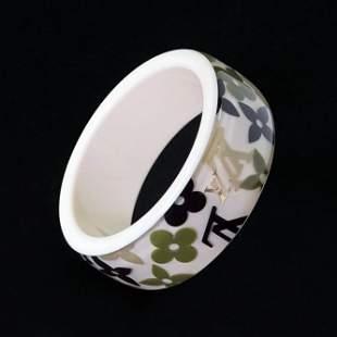 A Louis Vuitton Inclusion Bangle Bracelet.