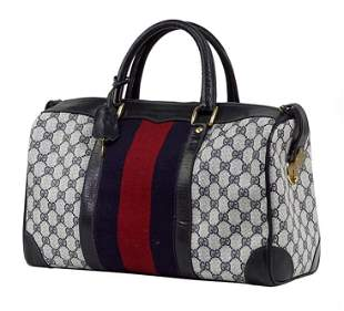 A Gucci Boston Handbag.