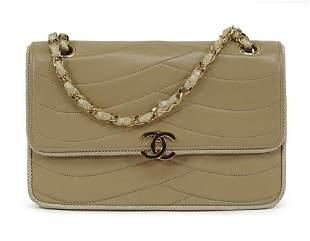 A Chanel Tan Leather Handbag.