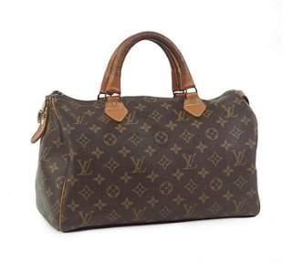A Louis Vuitton French Company Speedy Handbag.