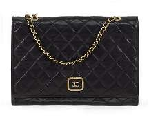 A Chanel Shoulder Bag.