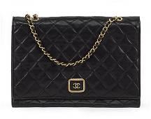 A Chanel Shoulder Bag.