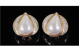 A Pair of Diamond & Mabe Pearl Earrings.