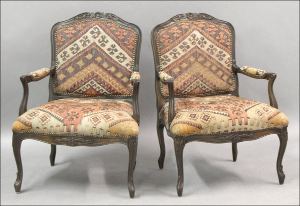 801008: PAIR OF FRENCH CARVED WALNUT BERGERES WITH KILI