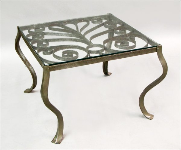 801010: IRON AND GLASS COCKTAIL TABLE.