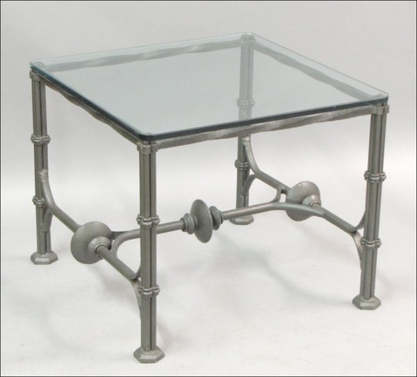 801011: CAST METAL AND GLASS COCKTAIL TABLE.