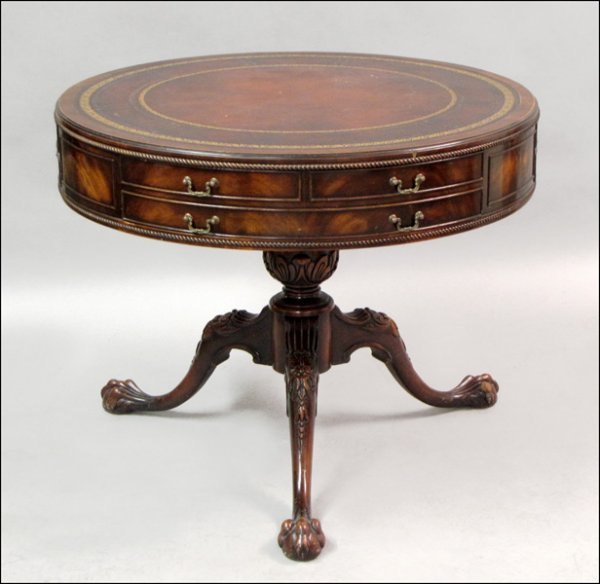 CARVED MAHOGANY DRUM TABLE.