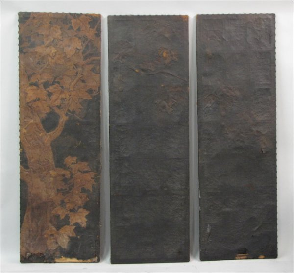 THREE HAND TOOLED LEATHER SCREENS.