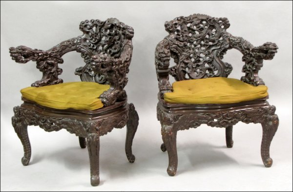 PAIR OF CHINESE CARVED WOOD DRAGON MOTIF ARMCHAIRS.