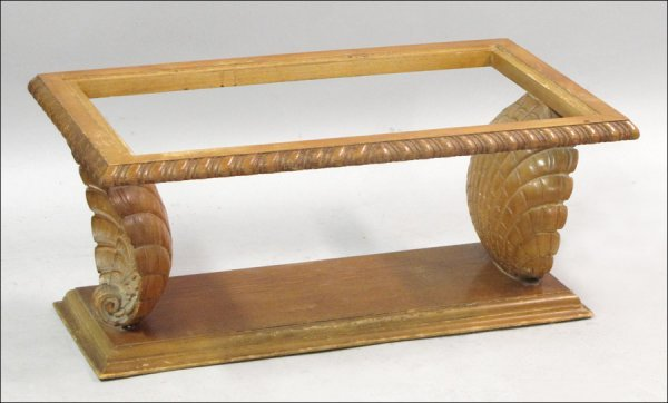 CARVED WOOD SHELL FORM COCKTAIL TABLE.