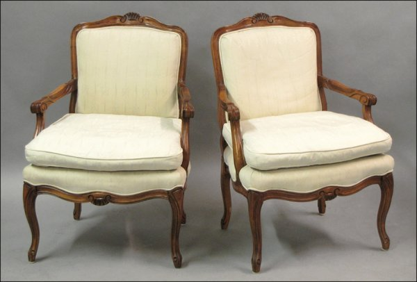 PAIR OF FRENCH STYLE CARVED WOOD ARMCHAIRS.