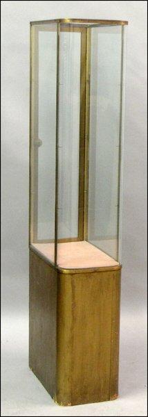 AMERICAN BRASS AND GLASS VITRINE.
