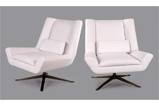 A Pair of Restoration Hardware Luke Swivel Chairs.