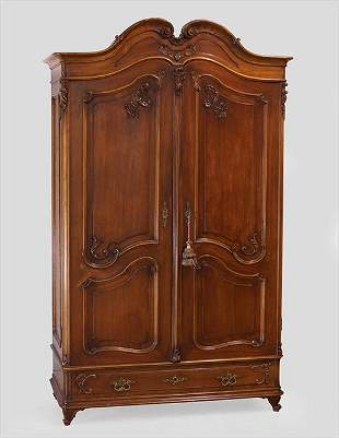 A Carved Walnut Armoire.