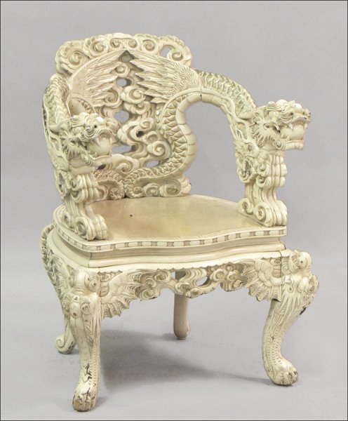 831010: CHINESE CARVED WOOD DRAGON MOTIF CHAIR.