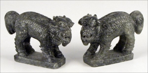 833002: PAIR OF CHINESE CARVED HARDSTONE LIONS.