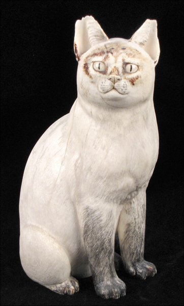 833003: CARVED AND PAINTED IVORY CAT.