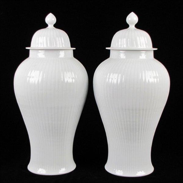 833004: PAIR OF WHITE PORCELAIN LIDDED TEMPLE JARS.
