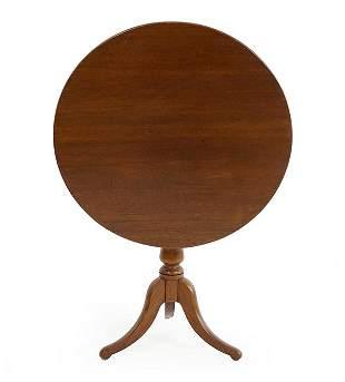 A 19th Century Walnut Tilt Top Table.
