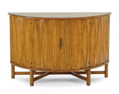 A Heritage Walnut Demilune Two-Door Cabinet.