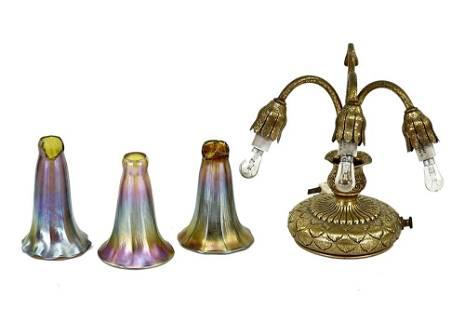 A Tiffany Studios Three-Light Lily Lamp.