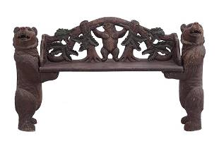 A Black Forest Carved Wood Bench.