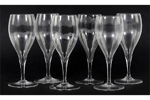 A Set of Six Baccarat Crystal Champagne Goblets.