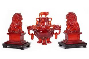 A Pair of Faux Amber Foo Lions.