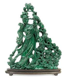 A Chinese Carved Malachite Figure of Quan Yin.
