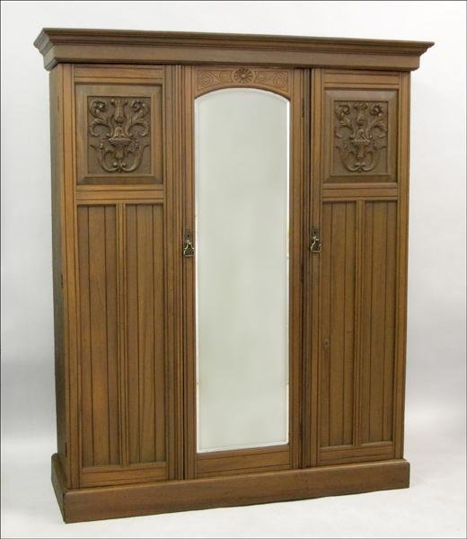 851001: MAHOGANY MIRRORED ARMOIRE.