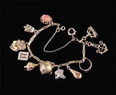 A Victorian Goldfilled Charm Bracelet.