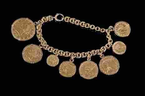 A Yellow Gold Charm Bracelet.