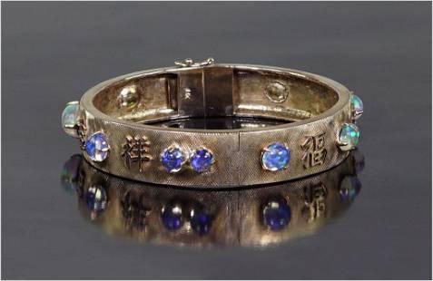 An Opal Bangle Bracelet.