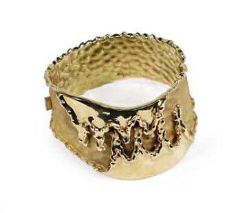 An 18 Karat Gold Bangle Bracelet.