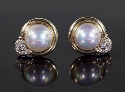 A Pair of Mabe Pearl & Diamond Earclips.