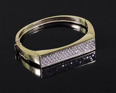 A Diamond Bangle Bracelet.