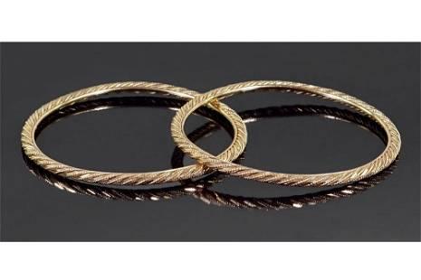 A Pair of 20 Karat Yellow Gold Bangle Bracelets.