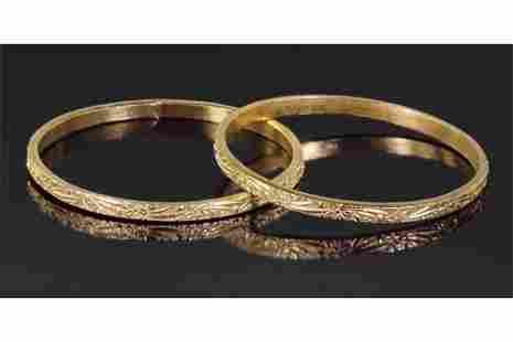 A Pair of 24 Karat Yellow Gold Bangle Bracelets.