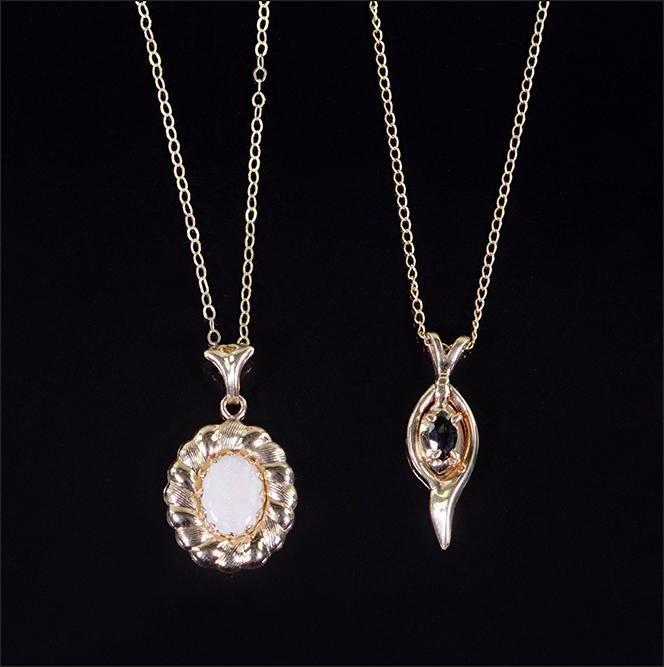 Two 14 Karat Yellow Gold Pendant Necklaces.