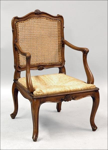 871002: FRENCH PROVINCIAL STYLE CARVED OAK ARMCHAIR.