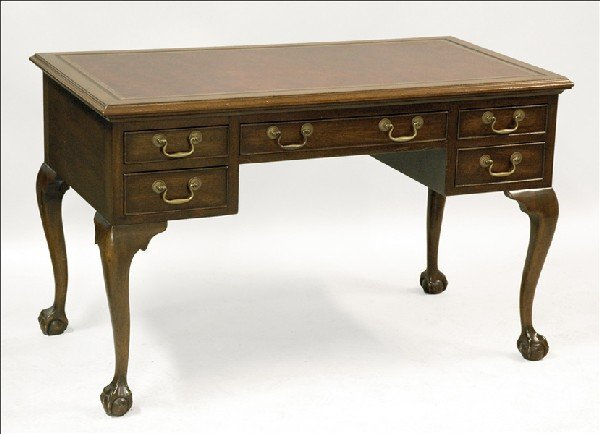 871003: CHIPPENDALE STYLE CARVED MAHOGANY DESK.